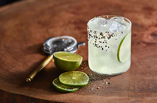 El Tesoro traditional margarita served in a rocks glass with lime juice and lime wheel garnish