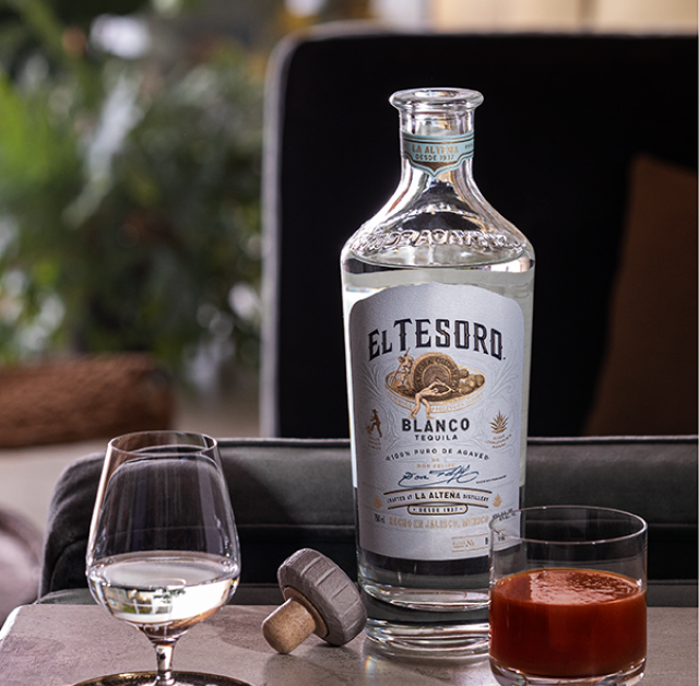 Sangrita drink recipe served in a rocks glass next to a snifter glass with El Tesoro's Blanco Tequila served neat.