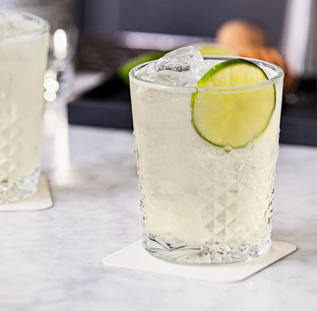 Tommy's Margarita recipe served in rocks glasses with El Tesoro's Blanco tequila.